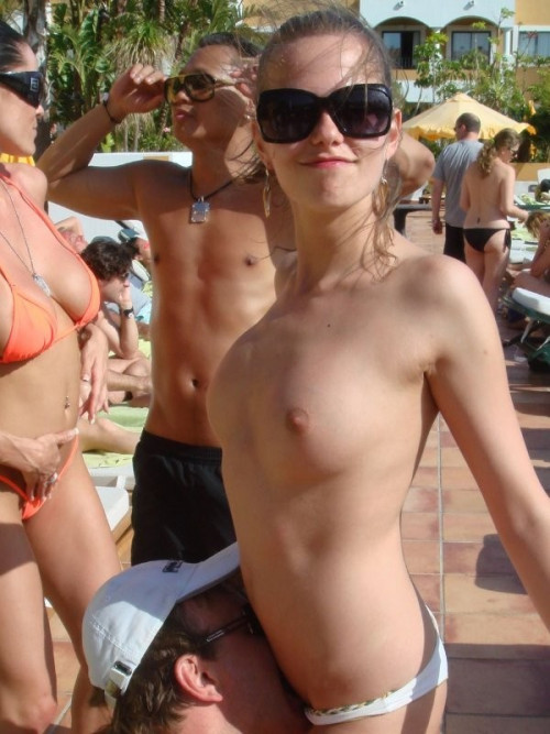 Topless-Slut-Getting-Licked-By-The-Pool.jpg